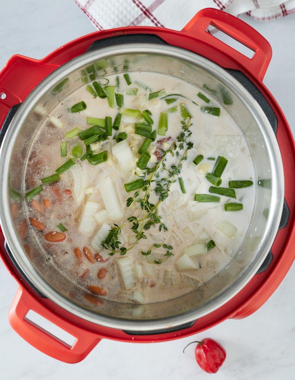 stew peas ingredients in pressure cooker before cooking
