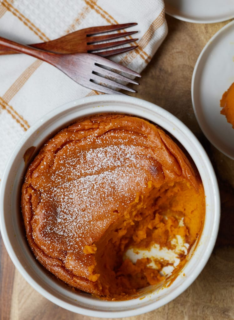 A carrot souffle topped with powdered sugar.