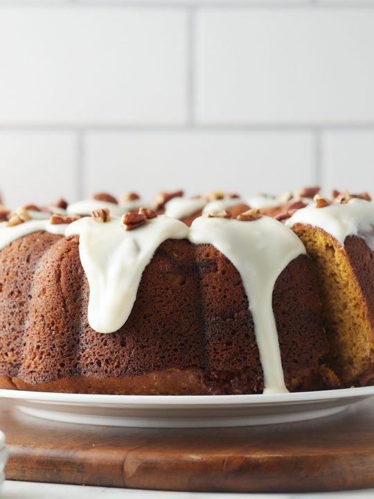 Sweet potato bundt cake with glaze served on a plate.